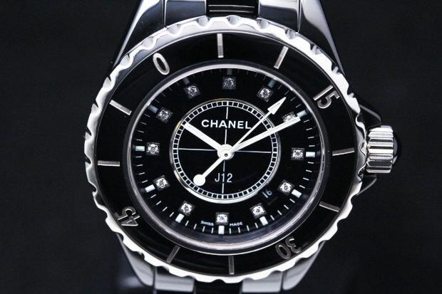 Sport watch style. Watch label: Swiss Made